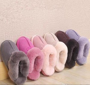 Hot sell Classic design Warm slippers goat snow boots Martin boots short women boots keep warm shoes DORP shipping