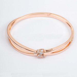 جودة الفاخرة سحر الشرير سوار مع الماس وعقدة الشكل في اثنين من الألوان مطلي للنساء مجوهرات الزفاف هدية لديها ختم PS8234