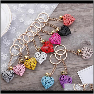 20Pcs Lot Wholesale Hollow Heart Keychains Fashion Charm Cute Purse Bag Pendant Car Keyring Chain Ornaments Gift Keychains T200804 P3E Qahej