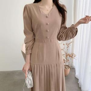 Korean spring simple V-neck bubble over the knee pleated skirt bandage waist long sleeve dress