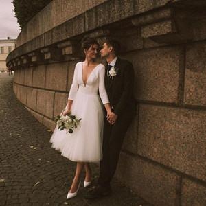 2021 Short Wedding Dresses Sexy Deep V Neck A Line 3 4 Long Sleeves Bridal Gowns Buttons Back Tea Length Outdoor Wedding Reception Dress
