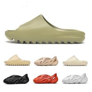 2021 KAWS Slipper Hombres Mujeres Slide Thone Tierra Marrón Desierto Arena Diapositiva Diapositiva Resina Zapatos Baratos Sandalias Espuma Runner Sesame Street