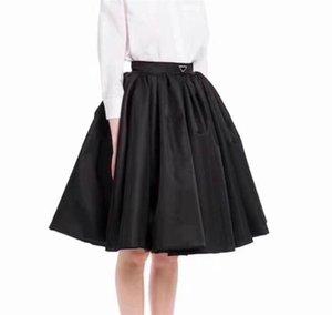 21ss Женщины Юбка Юбка Спицзы Высококачественные Леди половины платья с перевернутым треугольником спички юбки для весенних осенних вариантов