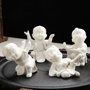 Soporte de taza creativa Té de porcelana blanca PET mascotas Decoración del hogar Kung Fu Kid Crafts Conjunto de té Accesorios Ceramic Little Monk Adornos