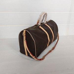 45 50 55 سنتيمتر حقائب فاخرة سعة كبيرة النساء حقائب السفر جلد طبيعي جودة عالية مصمم الرجال الكتف القماش الخشن حقيبة على الأمتعة أسفل المسامير مع قفل الرأس