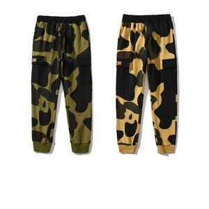 20ss pantalones para hombre pantalones de alta calle para mujeres pantalones deportivos pantalones de chándal reflectantes para hombre casual hip hop camo streetwear camo de alta calidad con caja