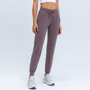 L-31 Женщины Женские штаны Slim были тонкие брюки йоги с карманами Спорт Фитнес Брюки на открытом воздухе Мода Леди Свободные прямые Джоггерные наряды Дышащие мягкие ладонные штаны