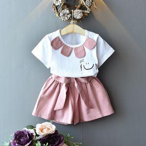 Детские дизайнерские Одежда для девочек Летняя одежда Хлопчатобумажная улыбка Facet-рубашка и шорты средних и маленьких девочек наряды 817 V2