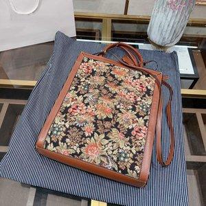 Flores bordadas verticales Venta de cuero real genuino Hot Classic Classic Moda de alta calidad Mujeres Graciosos bolsos Bolsos de compras Monederos