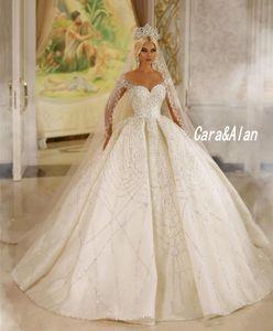 Luxury Arabic Dubai Wedding Dresses For Women 2021 Sequin Beaded Long Sleeves Sheer Neck Bridal Gowns vestido de noiva