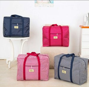 Oxford cloth business travel storage bag moving bag waterproof handbag clothing finishing bag pull rod luggage for men and women