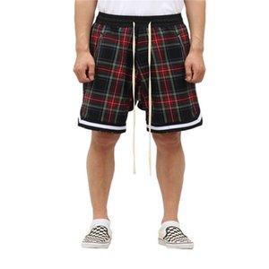 Hombre escocés a cuadros de gran tamaño de la calle de alto callejero de malla de malla tartán de gota de malla corporas lateral longitud de la rodilla de la rodilla