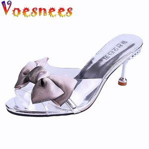 Voesnees Borrar zapatillas Mujeres Verano 2021New Mid-tacón Moda Mariposa-Kno Tacones altos 6.5 cm Femenino Stiletto Salvaje exterior Diapositivas