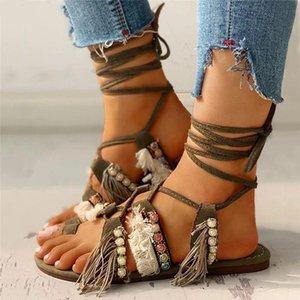 Sandalen 2021 Frauen Gladiator Tanga Sandale Quaste Frau String Perle Kreuz gebunden Flache Schuhe Weibliche Lace Up Damen Sommer Plus Größe