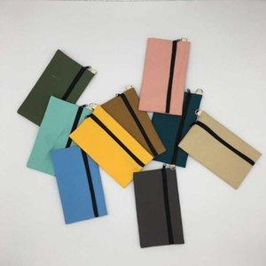لون الأزياء قماش قلم رصاص سستة القلم حقيبة مستحضرات التجميل الهاتف المحمول حقيبة يد حقيبة تخزين السفر المحمولة العملية