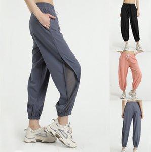 L-010 Женщины тренировки спортивные брюки йога наряд голые чувствуют тканевые пробежки брюки талии шнурки бегущий пот танец с двумя боковыми карманами