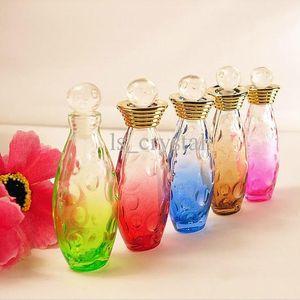 Coleccionable 5 ml MINI Botella de perfume de vidrio de color Óvalo Aroma vacío Botella de fragancia Tapas de rodillos Recargables Viales de aceite esencial 10pcs / lot