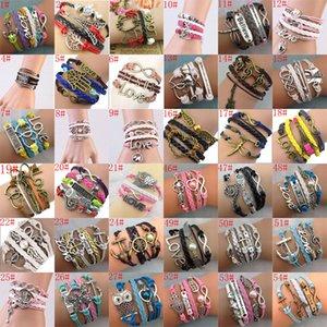 57 stili nuovi braccialetti trasversali fatti a mano della corda di cuoio dell'unità di elaborazione dei monili di modo dei braccialetti di fascino di infinito di Infinity di DIY nuovi Trasporto libero