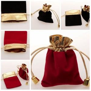 Chaud! 50pcs rouge / noir velours bijoux cadeau sacs sacs à cordon 9 x 12 cm