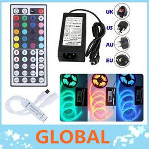 Les lumières étanches IP65 5M 300 Leds SMD 5050 RVB ont mené des bandes 60 leds / M + télécommande + alimentation 12V 5A avec prise EU / AU / UK / US / SW