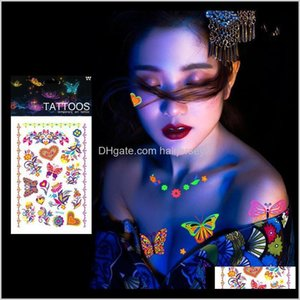Health Beauty Drop Delivery 2021 1 Sheet Luminous Temporary Tattoos Stickers Glow Dark Fluorescent Waterproof Butterfly Tattoo For Face Body