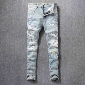 Street fashion men's jeans with holes painted