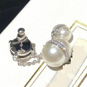 High quality super flash pearl water drill zircon Miu pendant planet tassel light luxury Earrings sweet wind Miao