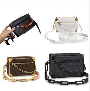 Luxurys Designers Flower symmetrical mini soft trunk Bags genuine leather Bucket Shoulder Pouch Women CrossBody fashion Cross Body handbag bag