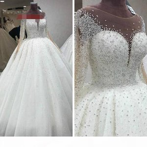 2021 Luxurious Beaded Crystal Wedding Dresses Princess With Illusion Long Sleeves White Tulle Sheer Neckline Hollow Back Ball Gown Vestidos