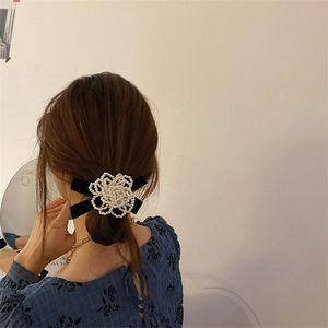 Aomu New Design Personalità Vintage Pearl Flower Twisted Black Bowknot Capelli Corda per le donne Party Accessori per capelli Accessori Gioielli Regali