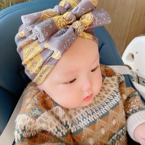Totems Printed Baby Hats Cartoon Infant Beanie Kids Bows Pleated Indian Hats Newborn Soft Ear Protection Caps Babies Skull Cap 06210224