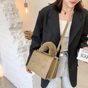 Moda estilo ocidental pequeno armazenamento quadrado na moda saco fêmea de pelúcia bolsa de pulso bolsa de ombro mensageiro designbags