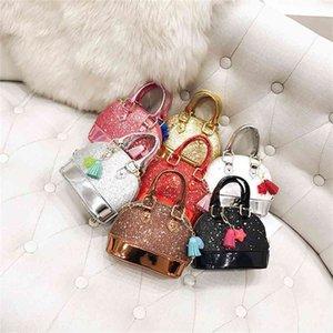 키즈 핸드백 어깨 가방 PU 쉘 스퓨린 가방 어린이 미니 토트 소녀 패션 디자이너 지갑 체인 귀여운 핸드백 8 색 판매 H52EF6G