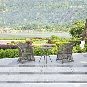 Открытый ротанговой мебель набор травы на открытом воздухе садовый диван стулья подушки журнальный столик