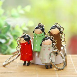 PVC Cute Raincoat Girl Doll Metal Keychain 4 style Cartoon 3D Key chain Pendant Bag Car Key Ring 24pcs lot wholesale