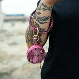 المعصم سلسلة المفاتيح الإناث بو أبل بلوتوث سماعة القلفة الجلود مرآة حقيبة مستحضرات التجميل سوار مفتاح سلسلة