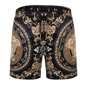 A2021 Tide brand printing trend Hawaiian men's short beach couple loose five-point casual pants sports