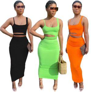 الصيف قطعتين اللباس النساء فساتين + الأعلى قصيرة أكمام السباغيتي حزام مجموعة من الجوف خارج الترفيه المنزل نمط تنورة تناسب المرأة الملابس 8306