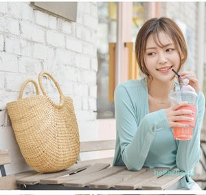 Female straw bag handmade yellow grass weave handbag colorful tassel wool ball beach bag