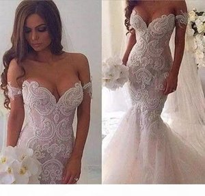 New 2020 African Appliqued Lace Mermaid Wedding Dresses Off shoulder Beaded Crystals Tulle Bridal Dresses Court Train Wedding Gowns Vestidos