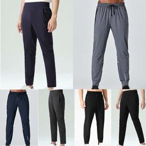 Designer lulu men pants yoga casual loose quick dry long pant running gym pocket lu jogger sports sweatpants jogging trouser pockets outfit bottom workout