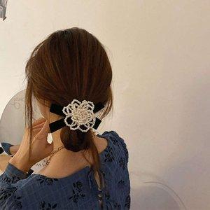 Headband South Korea Sweet Super Pearl Mountain Camelia Hairring Femmina Femmina Sensazione di alta qualità Minoranza Farfalle Ligature Scopa Tendine