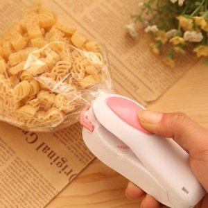 Portátil Mini Máquina de sellado térmico Alimento Clip de alimentos Impulso de la casa Bolsa de bocadillo Sellado Sello Utensilios de cocina Gadget Herramientas OOD5971