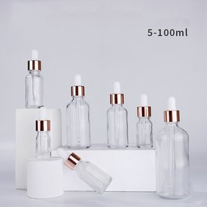 Wholesale clear serum glass dropper bottles 5ml 10ml 15ml 20ml 30ml 50ml 100ml with rose gold lid for essential oils