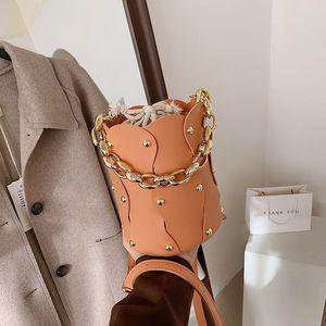 2021 Ins net red rivet splicing bucket bag women new solid acrylic Chain Handbag with drawstring