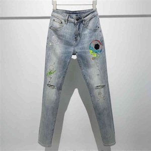 European goods tide brand MMJ color embroidered skull jeans hot drilled holes slim fit pants washed small feet pantsylr