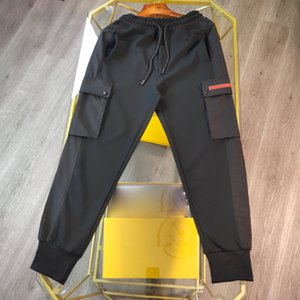 Мужские дизайнерские брюки осень зима плюшевые треугольник письма Италия Пингические карманные хлопковые мужчины женщины повседневные хлопковые брюки черный серый