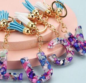 50 pieces Beautiful and fashionable 26 English alphabet keychain transparent acrylic crystal tassel pendant bag pendant FY2614