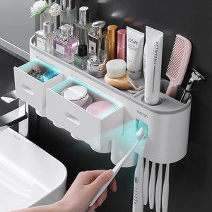 Spazzolino da denti creativo rack per punzonatura senza punzonatura senza punzonatura tazza di spazzolatura tazza da parete appeso bagno stoccaggio automatico dentifricio che spremuta dispositivo