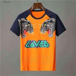 قمم تي بولو تي شيرت مصمم ملابس للرجال البرتقال إلكتروني الحيوان النمر الذئب طباعة الزى أحب المرقعة اللون عارضة المرأة بلايز تي شيرت الأعلى